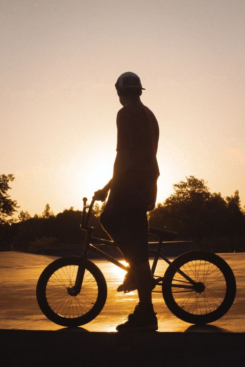 BMX and rider in front of the sunset